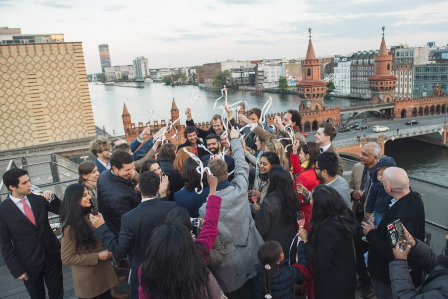 Celebrations at the end of Kate and Vish's Berlin wall wedding